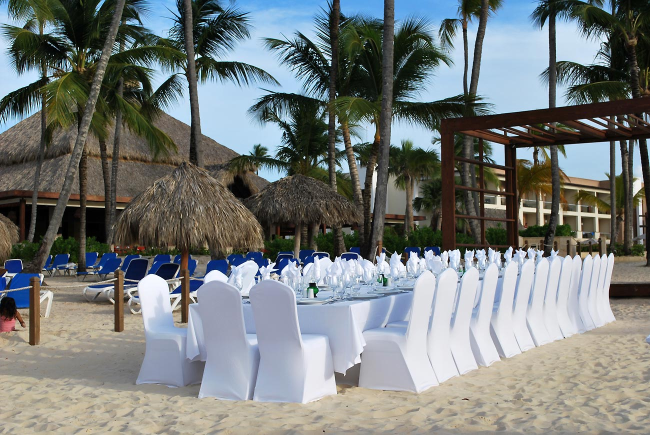 decorated wedding table on beach