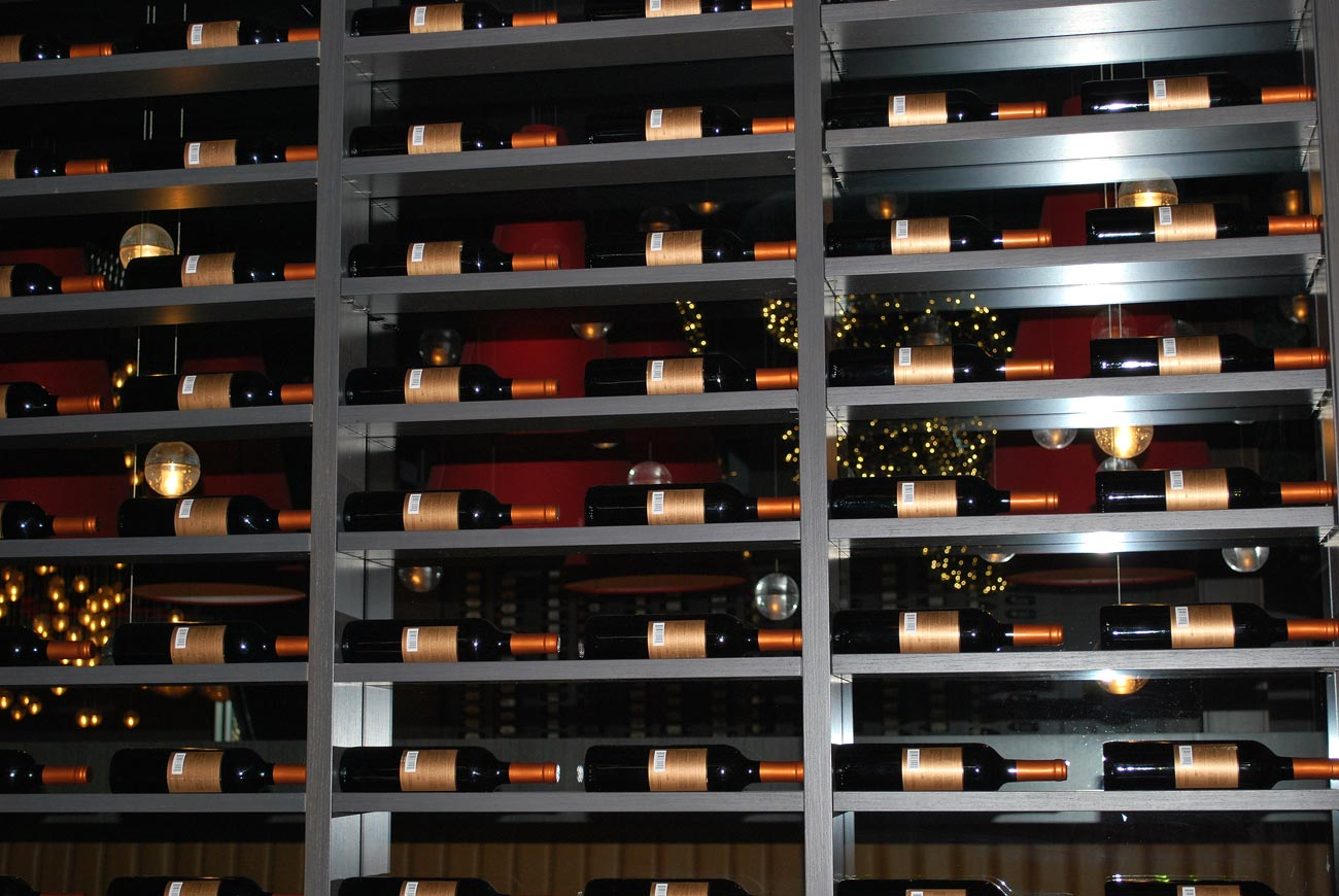 red wine bottles on shelf