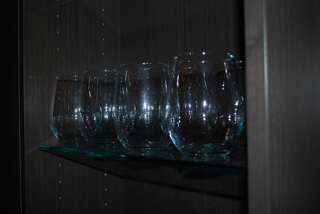 glasses sitting on shelf