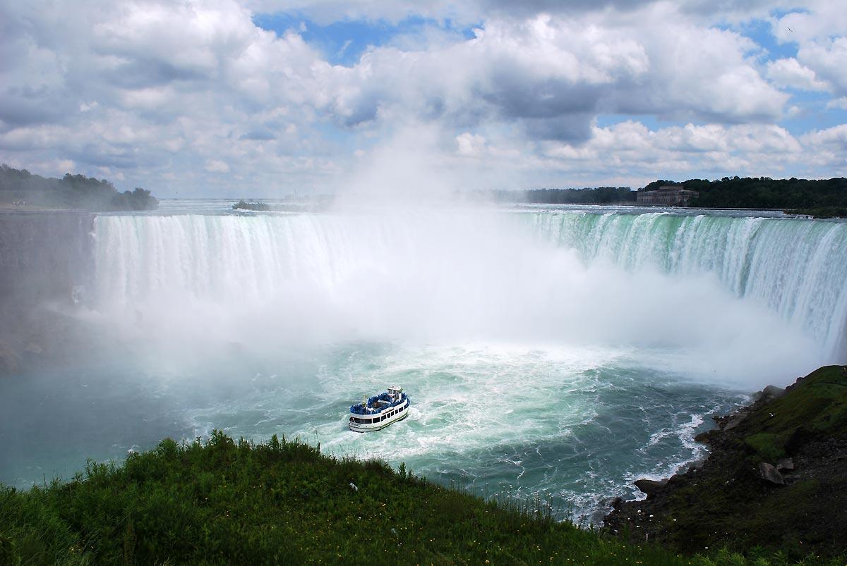 boat under waterfall