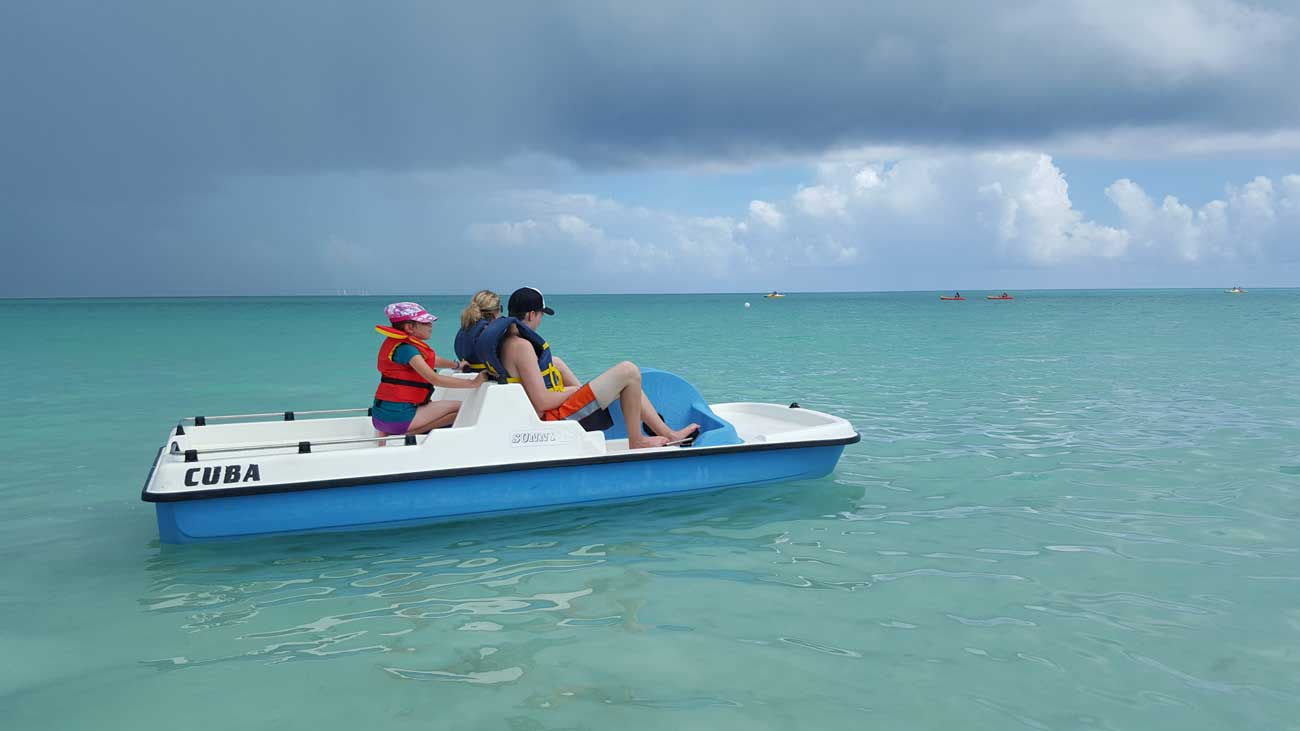family traveling on catamaran