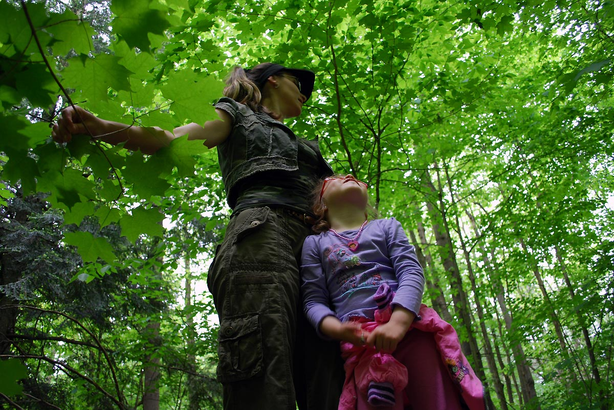 mom and daughter in forest