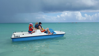 family traveling on catamaran